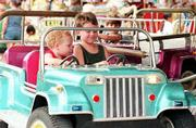 Miniature cars were a draw for these youngsters at last year's DeSoto Days. This year's watermelon festival features rides, crafts and other attractions, including child sumo wrestling and, of course, plenty of watermelons.