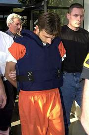 Wearing a bulletproof vest, multiple murder suspect Nikolay Soltys is taken from the Sacrameto County Sheriff's office to a waiting car to be transported to the Sacramento County Jail. Soltys was captured Thursday hiding under a desk in his mother's back yard in Citrus Heights, Calif.