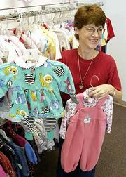 Second-hand clothing, for children ranging from newborns to those who wear size 10, are featured at Caryn Anderson's new business, The Elephant's Trunk, 4821 W. Sixth St.