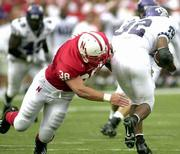Nebraska's Barrett Ruud (38) wraps up Texas Christian's Corey Connally. Ruud, a freshman, made his collegiate debut Saturday in Lincoln, Neb.