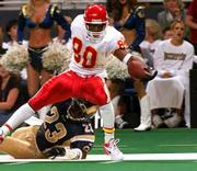 Kansas City's Larry Parker stretches for the end zone as he is dragged out of bounds by St. Louis' Devin Bush. The Rams edged the Chiefs, 21-17, on Friday in St. Louis.