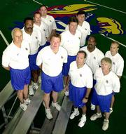 Kansas University's football coaching staff underwent a near complete overhaul in the offseason. KU's new-look coaching staff which will make its debut on the sideline tonight is, front row from left, Tom Hayes, head coach Terry Allen, Rip Scherer and Tim Burke; second row, from left, Clarence James, Johnny Barr, Travis Jones and Jay Johnson; third row, from left, Clint Bowen and Sam Pittman; and graduate assistant Rance Holt, back.