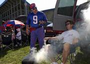 KANSAS TAILGATERS Don Murphy, left, of Lawrence, and Chuck Shrader, Wichita, discuss college football over beers and barbecue before kickoff outside Memorial Stadium. Saturday was the first day in a decade that Kansas University permitted alcohol at restricted locations for pre-game celebration. The rule change is expected to increase attendance.