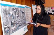 Jenny Thunder, a senior at Haskell Nations University, looks over poster boards that detail historical sites on the Haskell campus in areas considered for the South Lawrence Trafficway. Thunder was one of about 25 students to meet Wednesday at Stidham Hall with Mike Rees, chief counsel for the Kansas Department of Transportation.