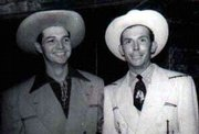 Hank Thompson, left, is pictured with country music legend Hank Williams Sr. Both musicians are wearing suits designed by iconic pop-culture clothing designer Nudie, who also made Elvis Presley's famed gold lamuit.