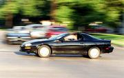 Columnist Seth Jones speeds through a Lawrence intersection in his 1999 Chevrolet Camaro in search of racing opponents.