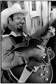 Hank Thompson plays a custom-made Gibson guitar that he refuses to take on airplanes, using it only at venues within driving distance.