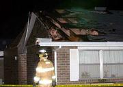 Some residents at the Eudora Nursing Center, 1415 Maple, had to be moved to a different wing after high winds damaged sections of roof on the two south wings. At the scene Friday night, a Eudora firefighter inspects the area outside the damaged building. At the upper left, damaged brick walls can be seen leaning into the building.