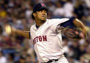 Pedro Martinez delivers a pitch against the Yankees. The Red Sox ace, who has an injured shoulder, lasted just three innings Friday in Boston's 3-2 loss at New York.