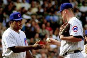 Chicago manager don baylor, left, takes the ball from pitcher Kerry Wood. The Cubs' ace made his first start after 35 days on the disabled list Friday at Chicago against Atlanta.