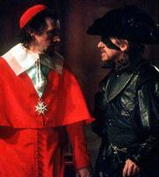 "Cardinal Richelieu Stephen Rea, left) consults with his henchman Febre (Tim Roth) in ""The Musketeer."""