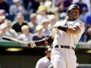 Barry Bonds blasts a home run in the fifth inning of Sunday's game against Colorado. Bonds blasted three round- trippers in the Giants' 9-4 win. He now has 63 for the season.