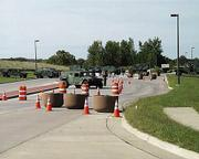 The Kansas National Guard entrance was blocked Tuesday afternoon in Leavenworth as security was tightened around the military fort there.