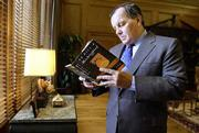 "Chicago Mayor Richard M. Daley looks through his copy of ""To Kill A Mockingbird,"" which he counts as a favorite. City officials for the next several weeks are promoting a program to get as many Chicagoans as possible to read and talk about the book at the same time."