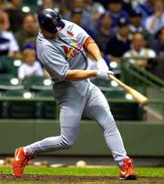 St. Louis slugger Mark McGwire hits a two-run home run in the second inning against the Milwaukee Brewers.