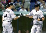 Jeff Liefer is greeted by white sox teammate Paul Konerko after Liefer's third-inning solo homer off Cleveland's Bartolo Colon Monday in Cleveland. The White Sox won, 7-1, and split the four-game series.