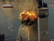Smoke and fire surround the upper floors of the World Trade Center in New York City, Tuesday, Sept. 11, 2001, in this image from television, after a second plane crashed into the building. Planes crashed into the upper floors of both World Trade Center towers minutes apart Tuesday in a horrific scene of explosions and fires that left gaping holes in the 110-story buildings.