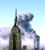 Plumes of smoke pour from the World Trade Center buildings in New York after planes crashed into the upper floors of the 110-story buildings. The Empire State building, seen in the foreground, was the scene of a plane crash in 1945. It remained intact and reopened for business within months.