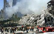 Hundreds of rescue workers continue their search as smoke rises from the rubble of the World Trade Center. No survivors from Tuesday's attack were found in Thursday's search.