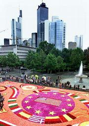 A large flower carpet in Frankfurt, Germany honors the victims of the terrorist attacks in New York and Washington. The carpet, originally designed by Belgian specialists to promote the new euro money, was changed in design with the Stars and Stripes at center and European flags around. Many Western nations are rethinking their open border policies in the wake of Tuesday's attacks.