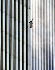 A person falls headfirst after jumping from the north tower of New York's World Trade Center. Dozens of people jumped to their death Tuesday in order to escape flames in the buildings.