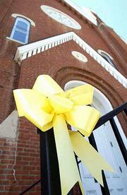 "Yellow ribbons like these outside Plymouth Congregational Church, 925 Vt., are being put up around town to show support for families and honor the victims of Tuesday&squot;s terrorist attack. Saturday, Plymouth will hold a ""Memorial for America"" at 10 a.m."
