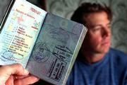 Mike Ramirez's passport bears stamps from some of the 100 countries he visited in eight years all for less than $60,000 total.