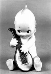 A mandolin-playing Kewpie figurine like this one sold recently for $475. The 4-inch-high figure is made of bisque.