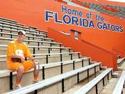 University of Tennessee freshman Keith Brakebill, 18, sits where he would have sat for Tennessee's game against Florida at Griffin Stadium. Brakebill headed to the stadium in Gainesville, Fla., on Thursday. By the time he learned the game had been postponed, he said Saturday, it was too late to turn around.