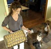 KHRISTINA KIRKSTATTER, proprietor of Lucky Paws Bakery, makes homemade dog treats by hand, selling them through area stores and farmers' markets. Kirkstatter believes that it is important to use healthy ingredients and avoid preservatives.