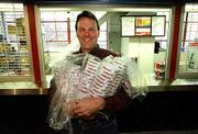 Lawrence businessman Steve Vormehr, owner of Mid-America Concessions Inc., has his hands full of cups as he finishes stocking concessions stands for a 1999 KU-Pepperdine football game in this file photo. Vormehr died of a sudden illness Thursday.