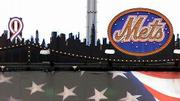 A ribbon is draped over the silhouette of the World Trade Center in the miniature New York skyline atop the scoreboard at Shea Stadium. Friday night's game between the Mets and Atlanta was the first major league game in New York since last week's terrorist attacks.