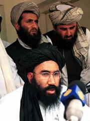 Taliban Ambassador to Pakistan Abdul Salem Zaeef speaks during a news conference in Islamabad. He said Friday that Afghan's Taliban rulers refused to hand over Osama bin Laden.