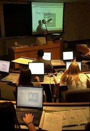 At Bentley College in Waltham, Mass., each student uses a laptop in class with access to the Internet that can can be controlled by a school-supported software program. The software is designed to curb students who pay more attention to their computers than to their professors, like Bill VanderClock teaching this information technology class.