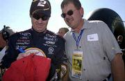NASCAR driver Rusty Wallace signs an autograph for a fan before Sunday's Protection One 400 at the Kansas Speedway.