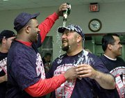 Cleveland reliever Bob Wickman, right, gets a champagne shower from rookie pitcher C.C. Sabathia in the clubhouse after the Indians' 9-1 win over the Twins on Sunday in Cleveland. The victory gave the Indians their sixth AL Central Division title in the last seven years.