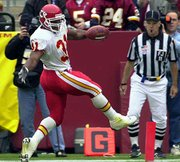Kansas City running back priest holmes dances into the end zone. Holmes scored three touchdowns Sunday in the Chiefs' 45-13 victory over Washington at Landover, Md.