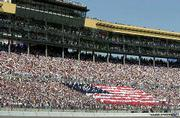 NASCAR fans display forma an american flag for the national anthem before the Protection One 400