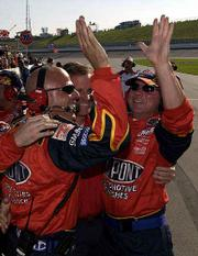 Jeff Gordon's pit crew celebrates following the dupont driver's victory at the Protection One 400.