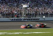 Jeff Gordon (24) leads Ricky Rudd (28) near the end of the Protection One 400. Gordon won Sunday at Kansas Speedway in Kansas City, Kan., while Rudd was third.