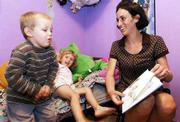 With a shortage of day-care facilities in the county, Jen Shaffer decided to open a home day-care business in Lawrence. Shaffer read a Sesame Street story to Jerek Humphrey, 3, left, and her daughter Cheyenne, 3, on Friday.