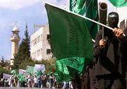 Palestinian demonstrators carry Hamas flags and mock weapons during a march in the West Bank town of Nablus. Nasser Hidmi, a Palestinian who came to the United States on a student visa, said he was recruited for the militant wing of Hamas while he was at Kansas State University.