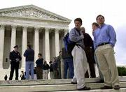 Spectators line up on the steps of the U.S. Supreme Court in Washington to watch the court begin its new session. The court Monday started its new term by suspending former President Clinton from the Supreme Court bar.