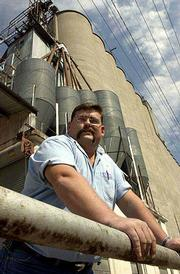 Tim Pearson, who is managing the North Lawrence elevator for Ottawa Cooperative Assn., braces for business during the bustling fall harvest. Pearson reports the elevator is receiving about 50 truckloads of soybeans and corn per day.