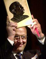"Ig Nobel Prize winner Viliumas Malinauskus, of Lithuania, holds up a plaque with the bust of Josef Stalin. Malinauskus was awarded the prize for creating the amusement park known as ""Stalin World."""