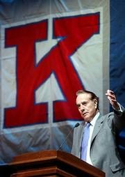Former Sen. Bob Dole addresses the crowd during the groundbreaking ceremony for the Robert J. Dole Institute of Politics at Kansas University. The new building will house Dole's political archives.