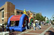 Kansas University's open house couldn't have had a better weekend. Temperatures Saturday were in the 60s with sunny skies. Thousands of onlookers took advantage of the mild weather to participate in the festivities, including a Moonwalk in front of the Kansas Union.