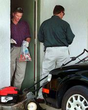 Investigators gather samples from the home of Robert Stevens in Lantana, Fla. Stevens, 63, died Friday after contracting the inhaled form of anthrax, an extremely rare and lethal disease. Investigators from the FBI and Centers for Disease Control and Prevention went through the home.