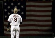 Baltimore's Cal Ripken faces a U.S. flag during a ceremony prior to the final game of his career Saturday night in Baltimore. Story on page 6C.