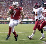 Nebraska quarterback Eric Crouch runs to the end zone. The Huskers defeated Iowa State on Saturday at Lincoln, Neb.